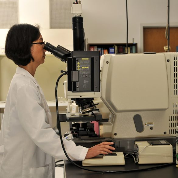 Materials characterization scientists at EAG using advanced microscopy, one of our many analytical techniques.
